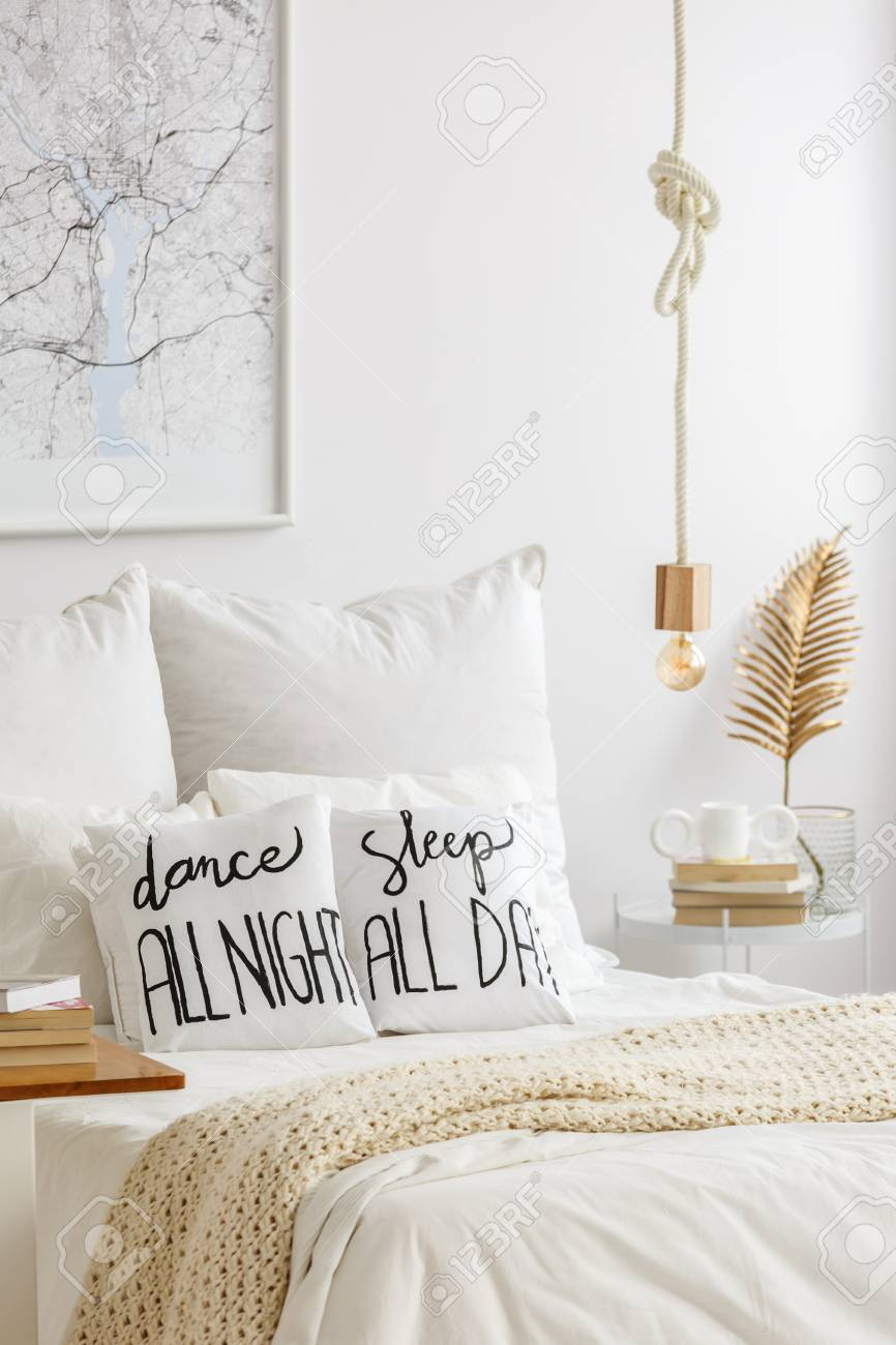 Rope Pendant Light Above A Cozy Bed With Quote Print Pillows Stock Photo Picture And Royalty Free Image Image 103183757