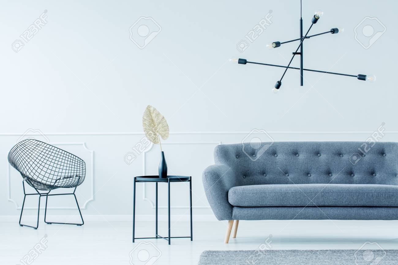 Industrial, Black Side Table Between A Modern, Metal Wire Chair And  Elegant, Gray