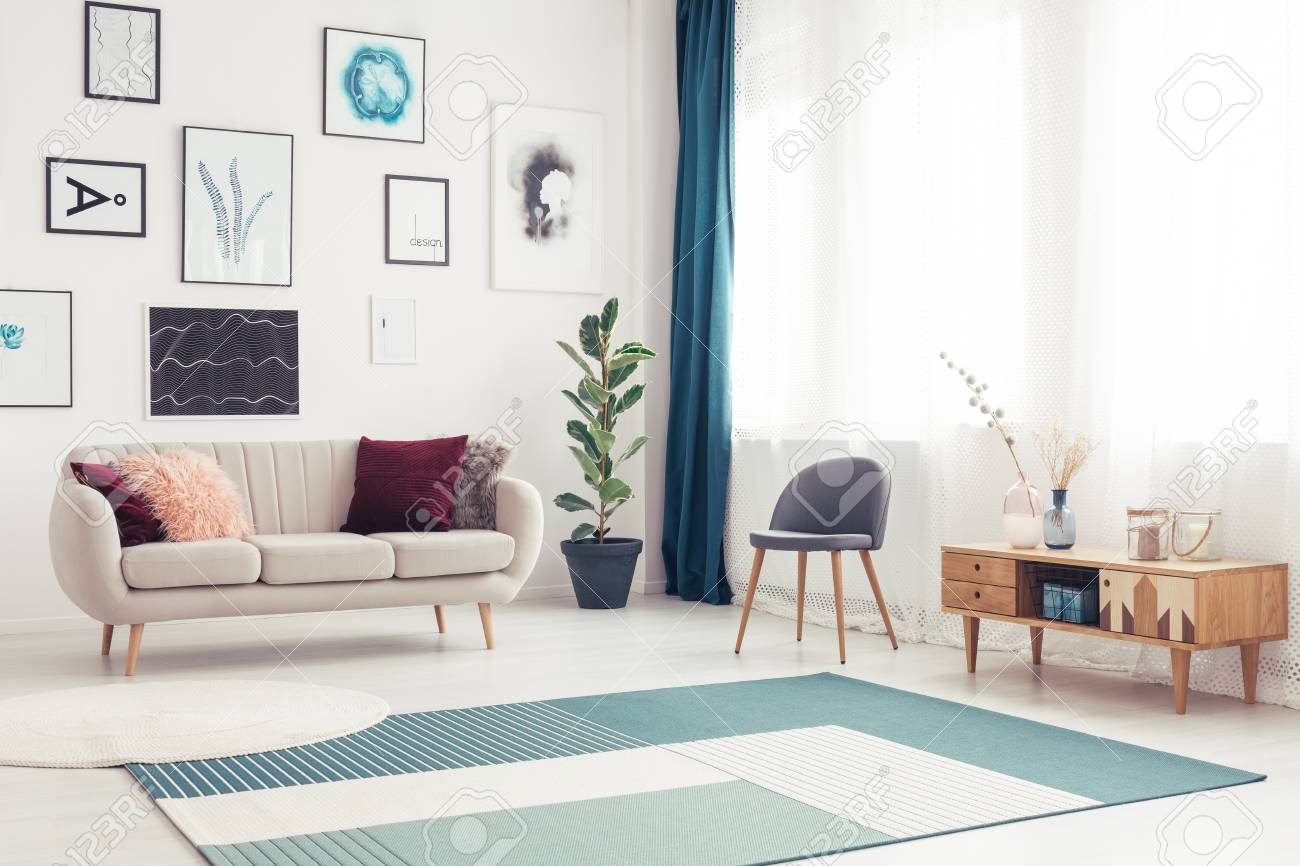 Side angle view of a modern living room with blue rug, elegant..