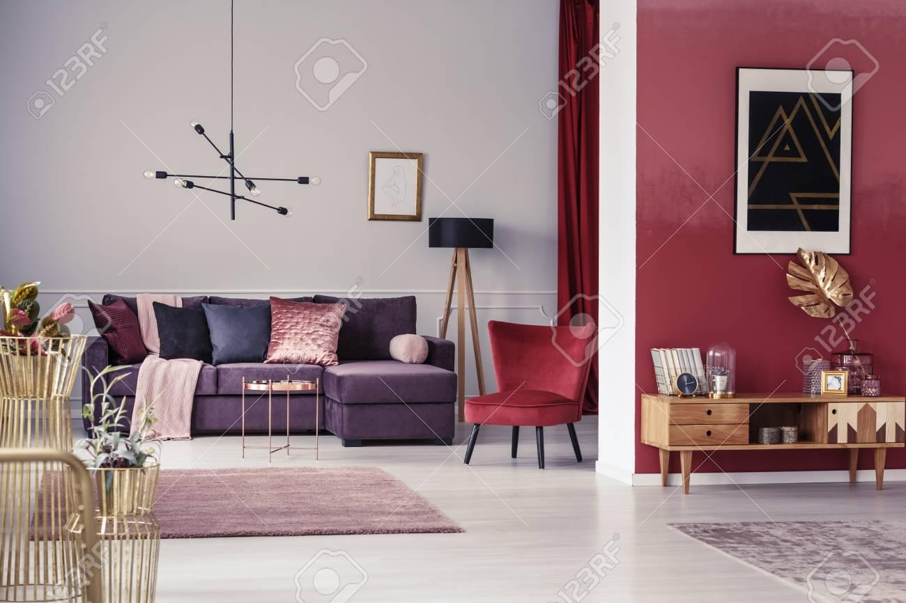 Spacious Maroon Apartment Interior With Corner Sofa Red Armchair And Wooden Cupboard Foto Royalty Free Gravuras Imagens E Banco De Fotografias Image 98946969