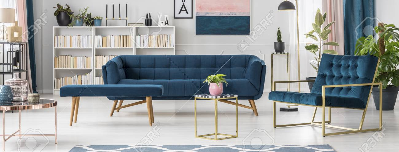 Blue Bench Next To Sofa In Modern Living Room Interior With Plant