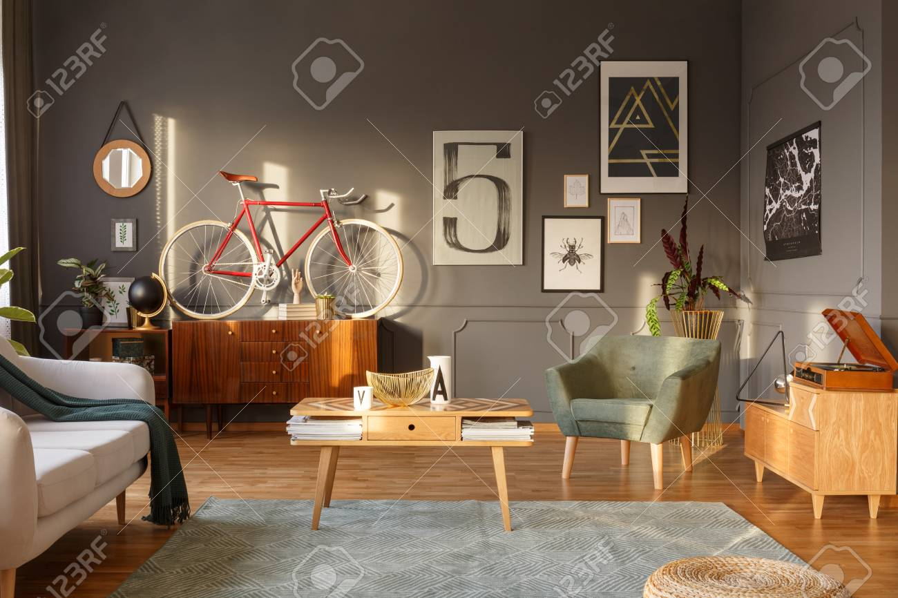 Wooden Coffee Table With Papers Red Bike On A Cabinet And Green Stock Photo Picture And Royalty Free Image Image 99295105
