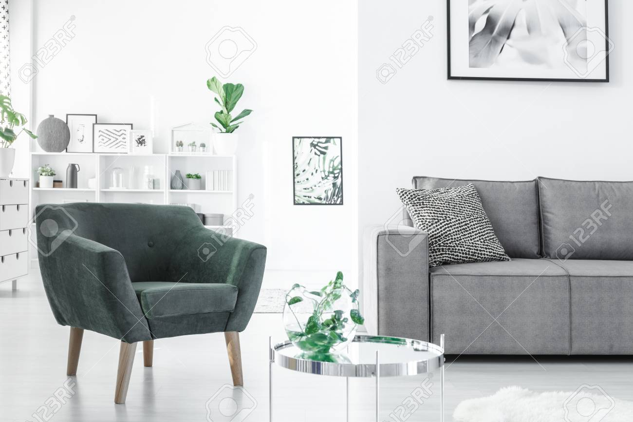 Green Armchair Next To Grey Sofa In White Apartment Interior.. Stock Photo, Picture And Royalty Free Image. Image 99643926.