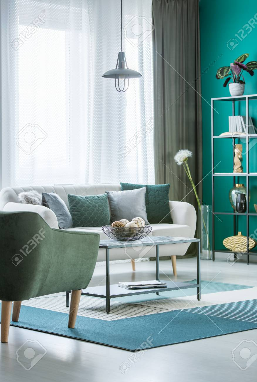 Metal Marble Table With Decorative Balls In Bowl In Green Living
