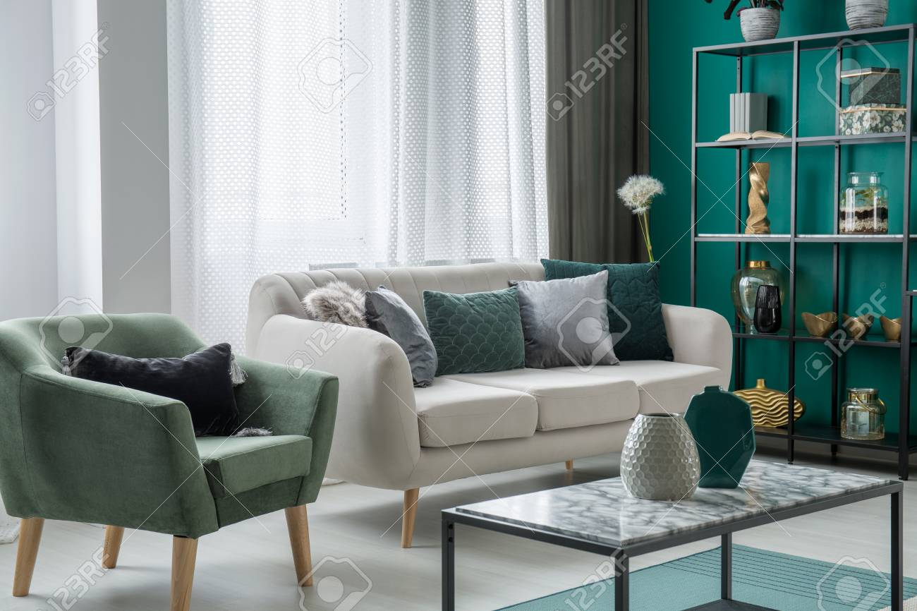 Image of: Green And Silver Decorative Pillows Placed On A Light Grey Couch Stock Photo Picture And Royalty Free Image Image 100735227