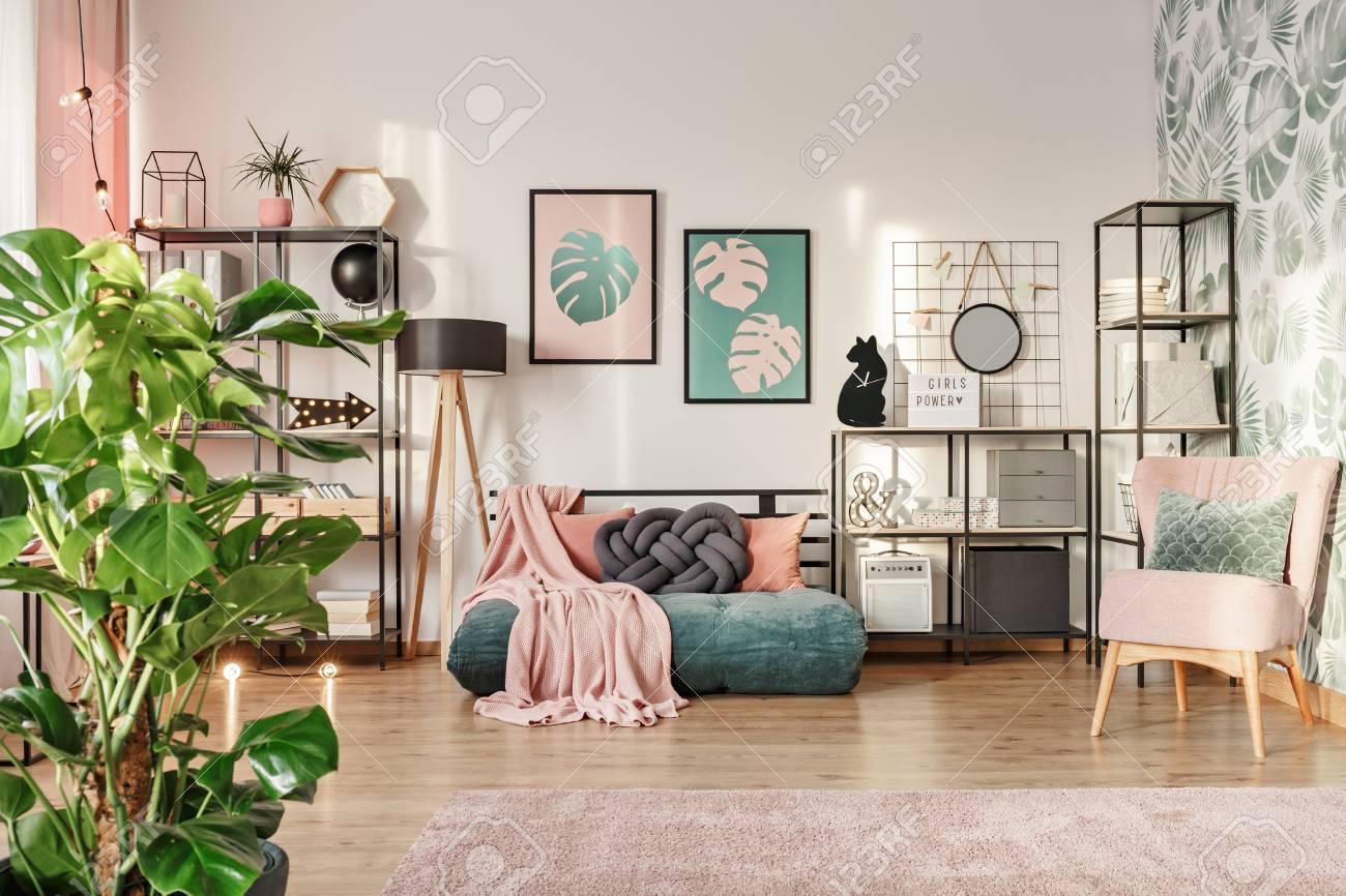 Knot Pillow On A Designer Emerald Green Mattress Sofa In A Living