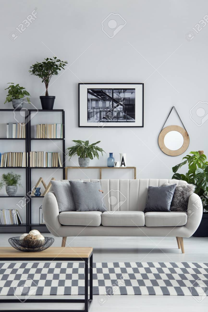 Beige Sofa In A Simple Design Living Room Interior With Black.. Stock Photo, Picture And Royalty Free Image. Image 101342597.