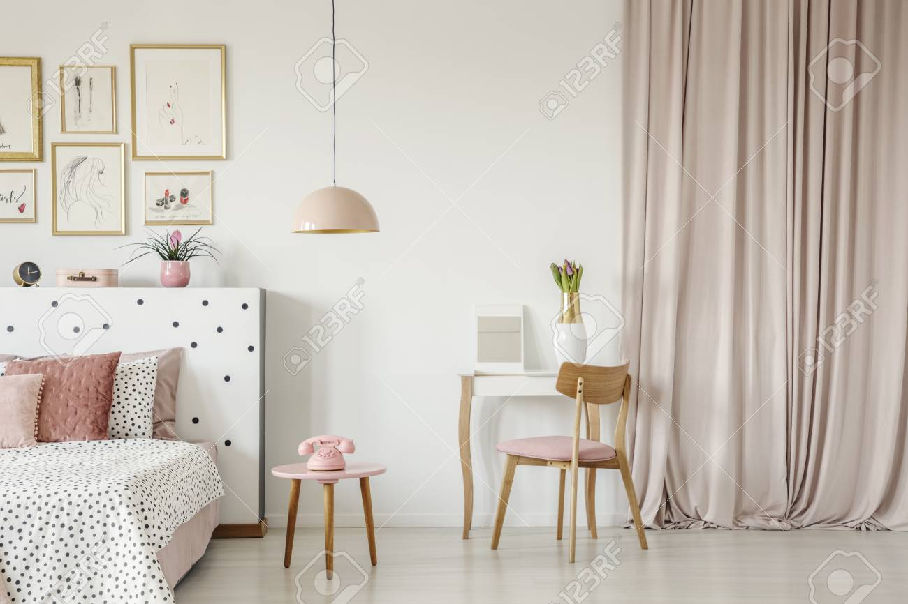 wholesale dealer 0ff53 6964d Wooden chair at dressing table in pastel pink bedroom interior..