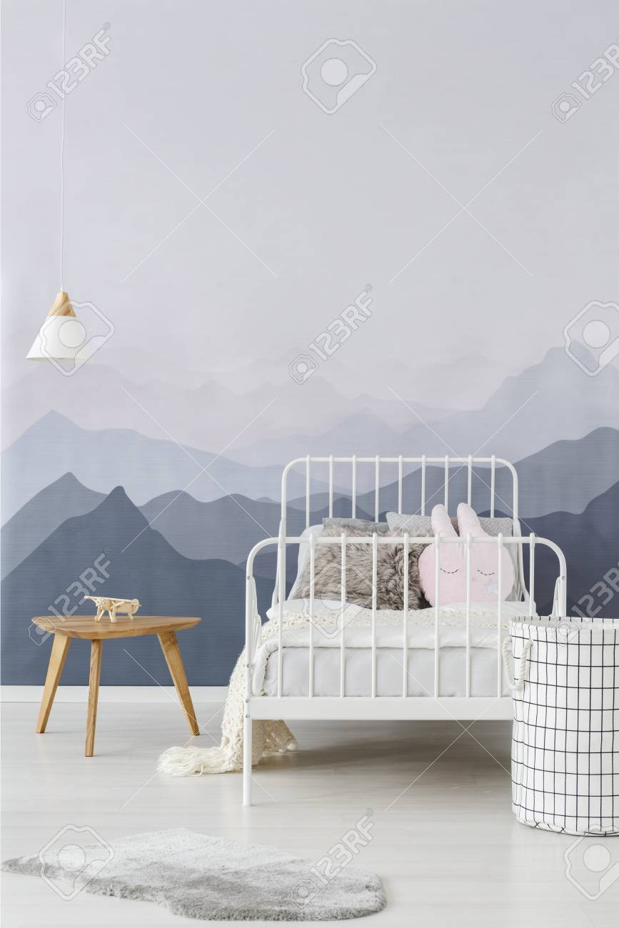 White Metal Frame Bed By A Wall With Mountains Wallpaper In A Stock Photo Picture And Royalty Free Image Image 101304359