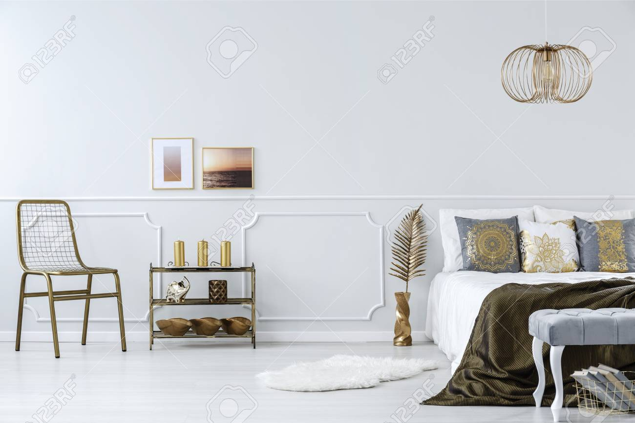 Gold Accents In Bedroom Interior With Bed Chair Metal Shelf Stock Photo Picture And Royalty Free Image Image 101410772