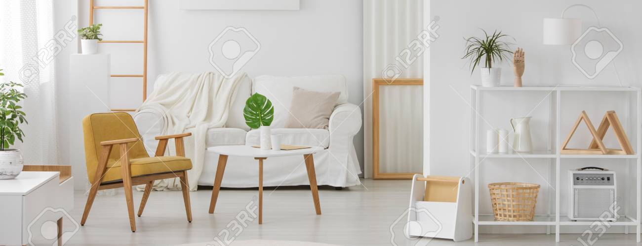 White Furniture With Wooden Elements In Monochromatic Living Room