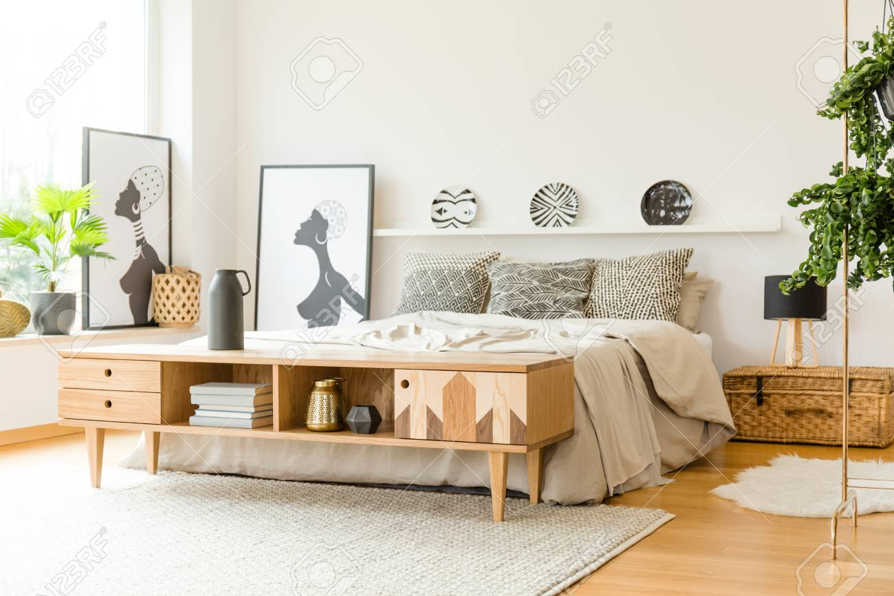 Wooden Cupboard Near Bed In Boho Bedroom Interior With Posters Stock Photo Picture And Royalty Free Image Image 101900011