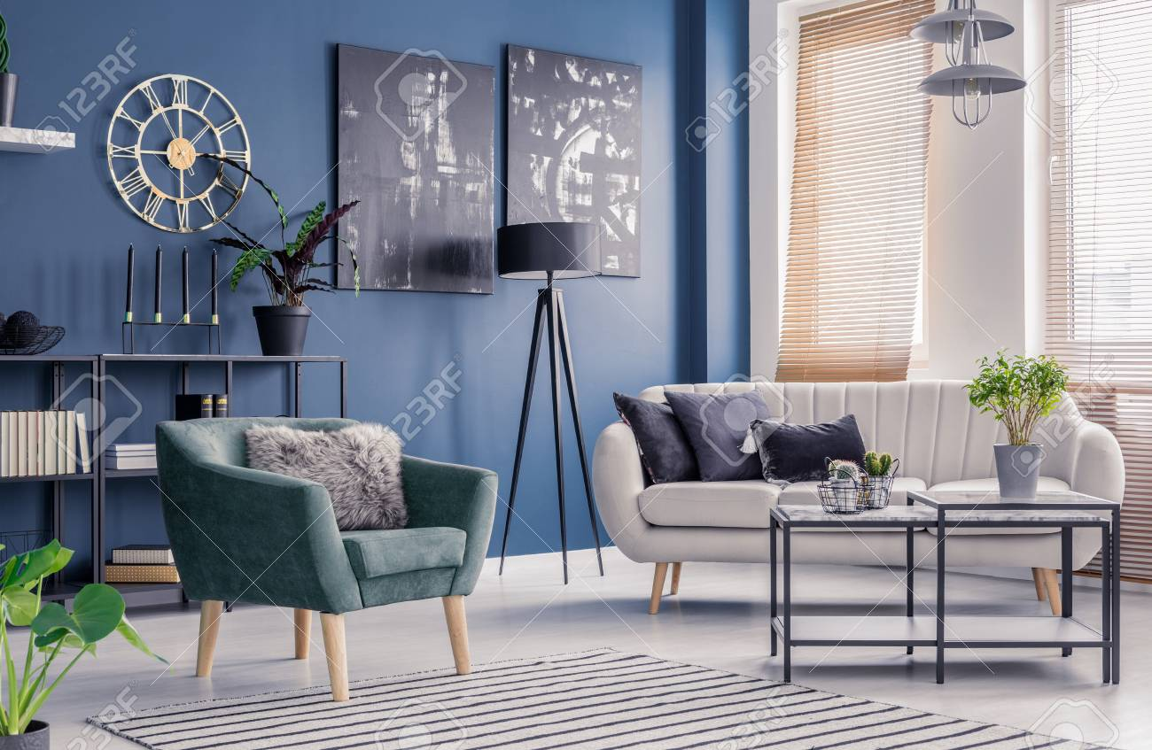 Navy Blue Living Room Interior With Designer Decor Black Artwork Stock Photo Picture And Royalty Free Image 101707626