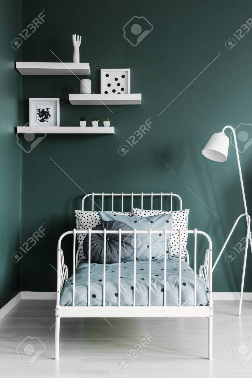 Shelves With Decorations And A Floor Lamp Above A White Metal Stock Photo Picture And Royalty Free Image Image 102145717
