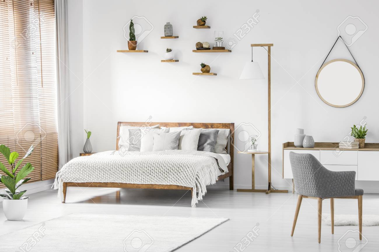 Front View Of A Bright Natural Bedroom Interior With Wooden Bed Stock Photo Picture And Royalty Free Image Image 102471718
