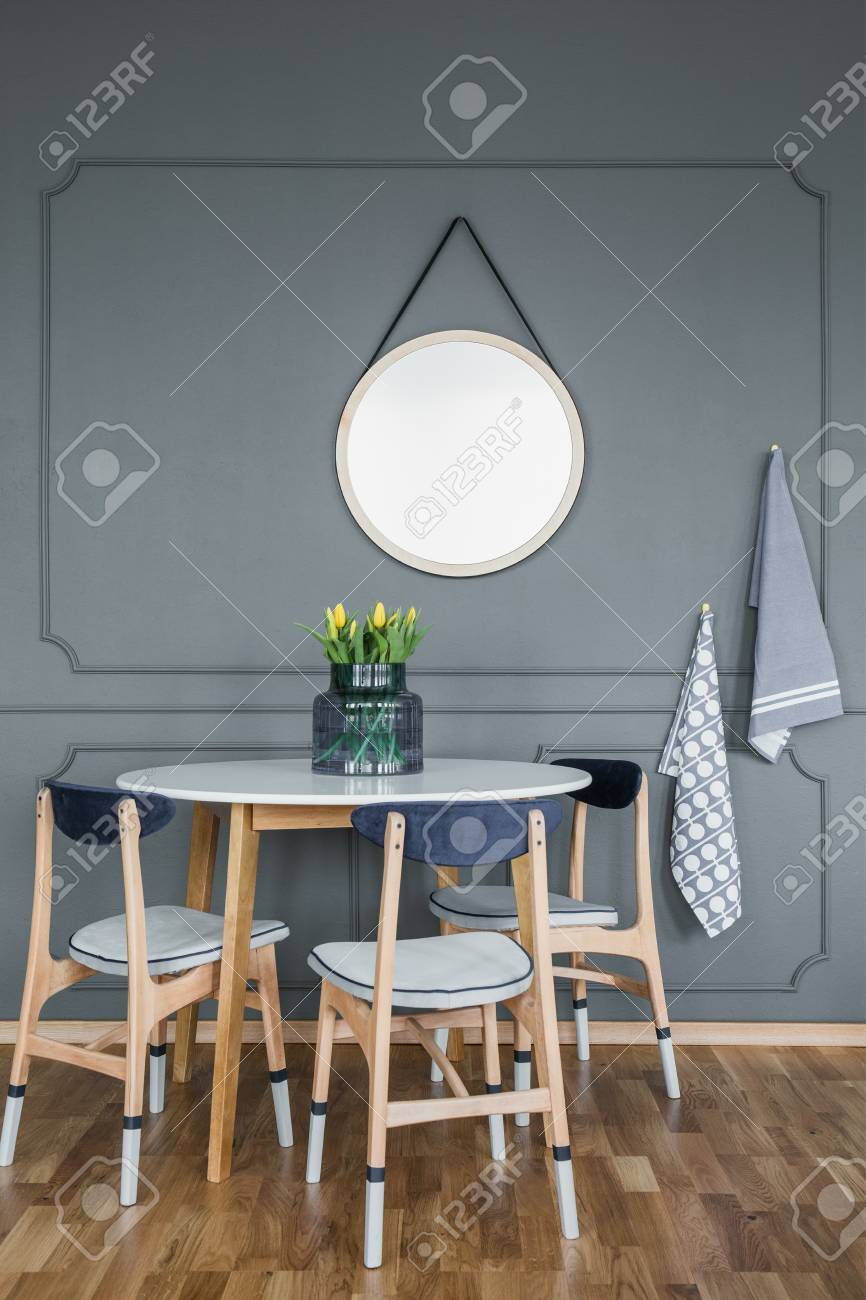 Mockup Of Round Mirror On Grey Wall Above Wooden Table And Chairs Stock Photo Picture And Royalty Free Image Image 102519778