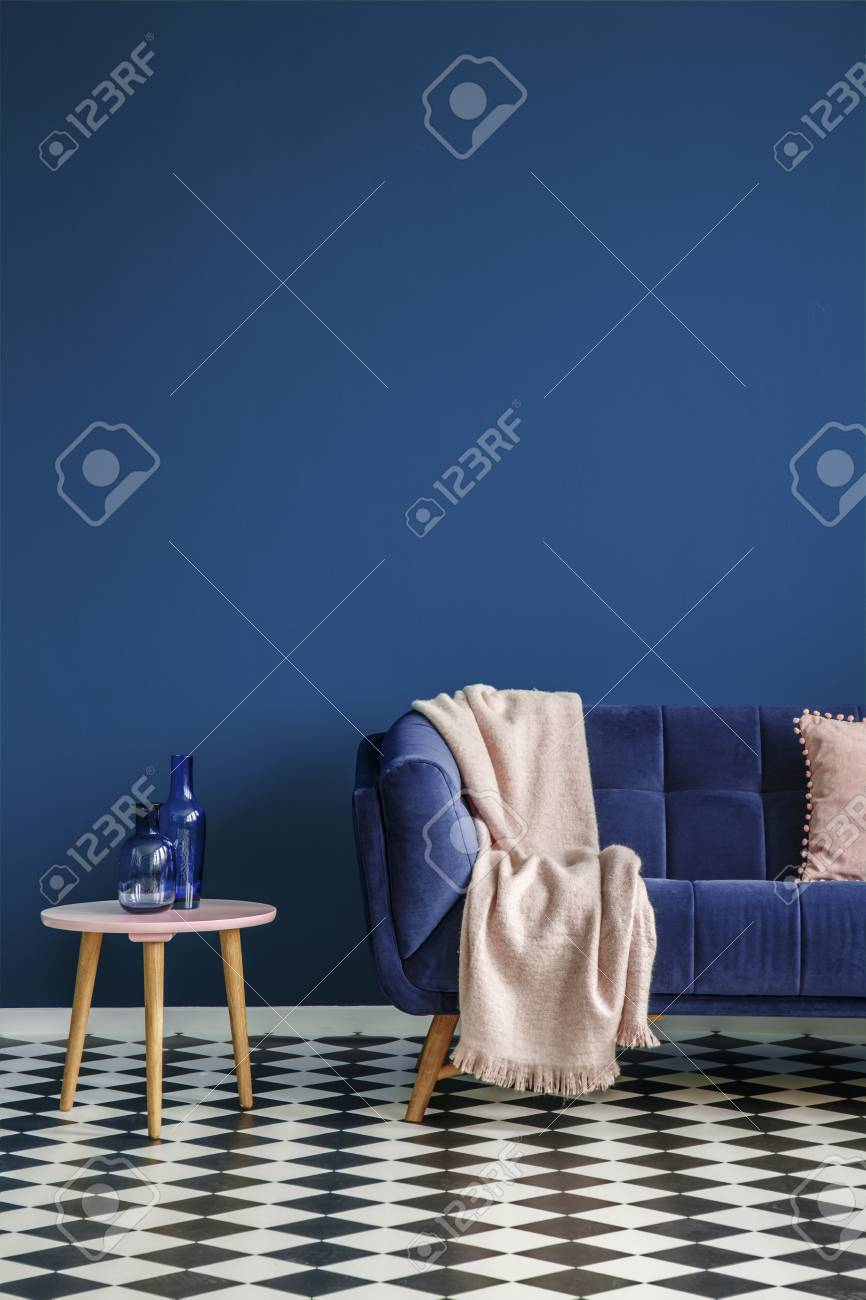 Chessboard Floor Sofa With A Blanket And Stool With Glass Decorations