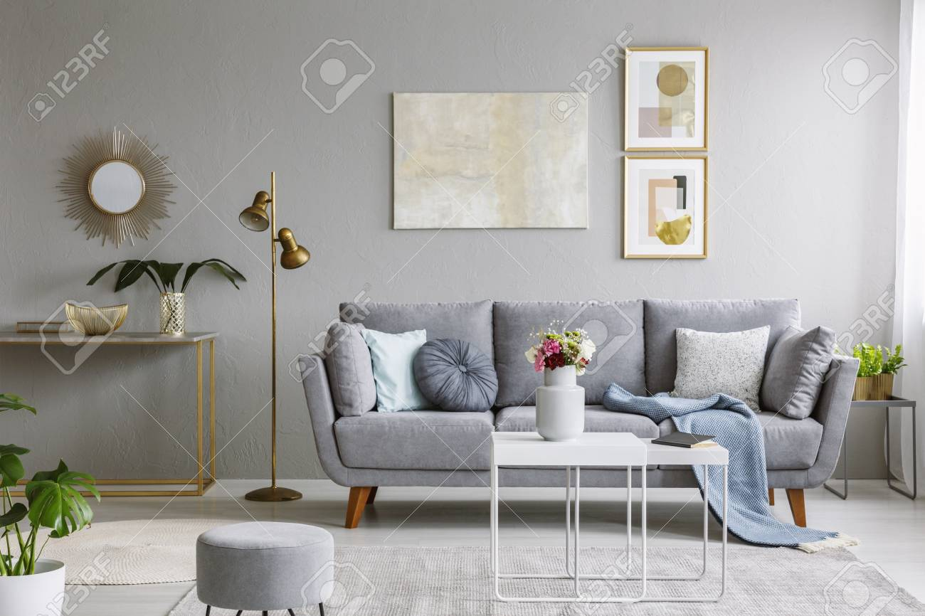 Real Photo Of A Grey Sofa With Cushions And Blanket Standing Stock