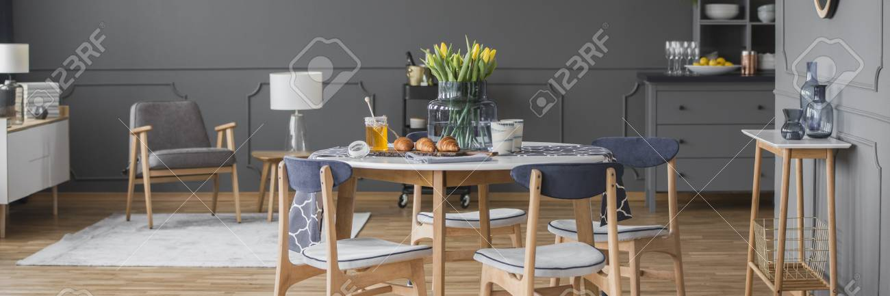 Grey Wooden Armchair In Open Space Interior With Chairs At Round Stock Photo Picture And Royalty Free Image Image 102921692