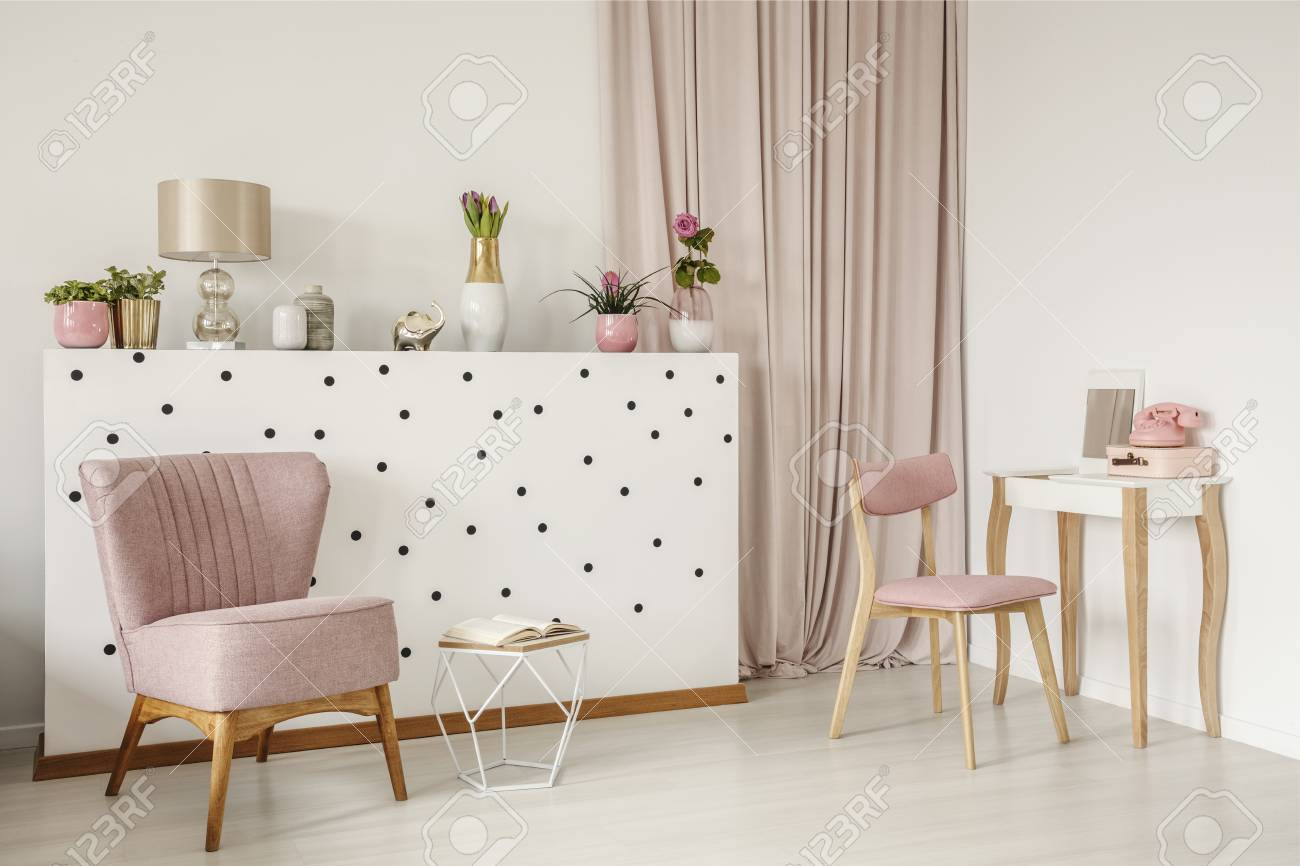 Elegant Armchair And An Open Book By A Polka Dot Wall Wooden Stock Photo Picture And Royalty Free Image Image 103552687