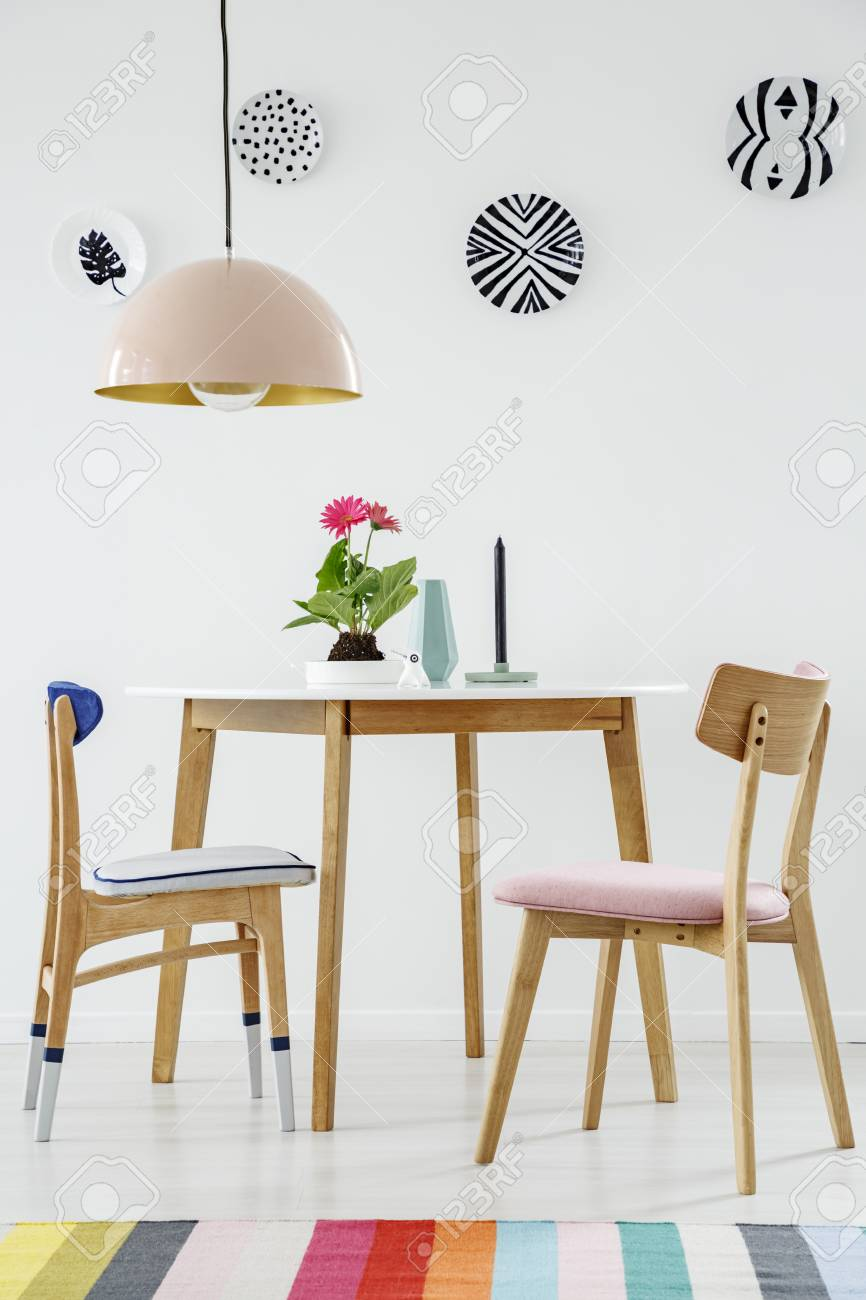 Picture of: Colorful Rug In Dining Room Interior With Wooden Chairs At Table Stock Photo Picture And Royalty Free Image Image 104117219
