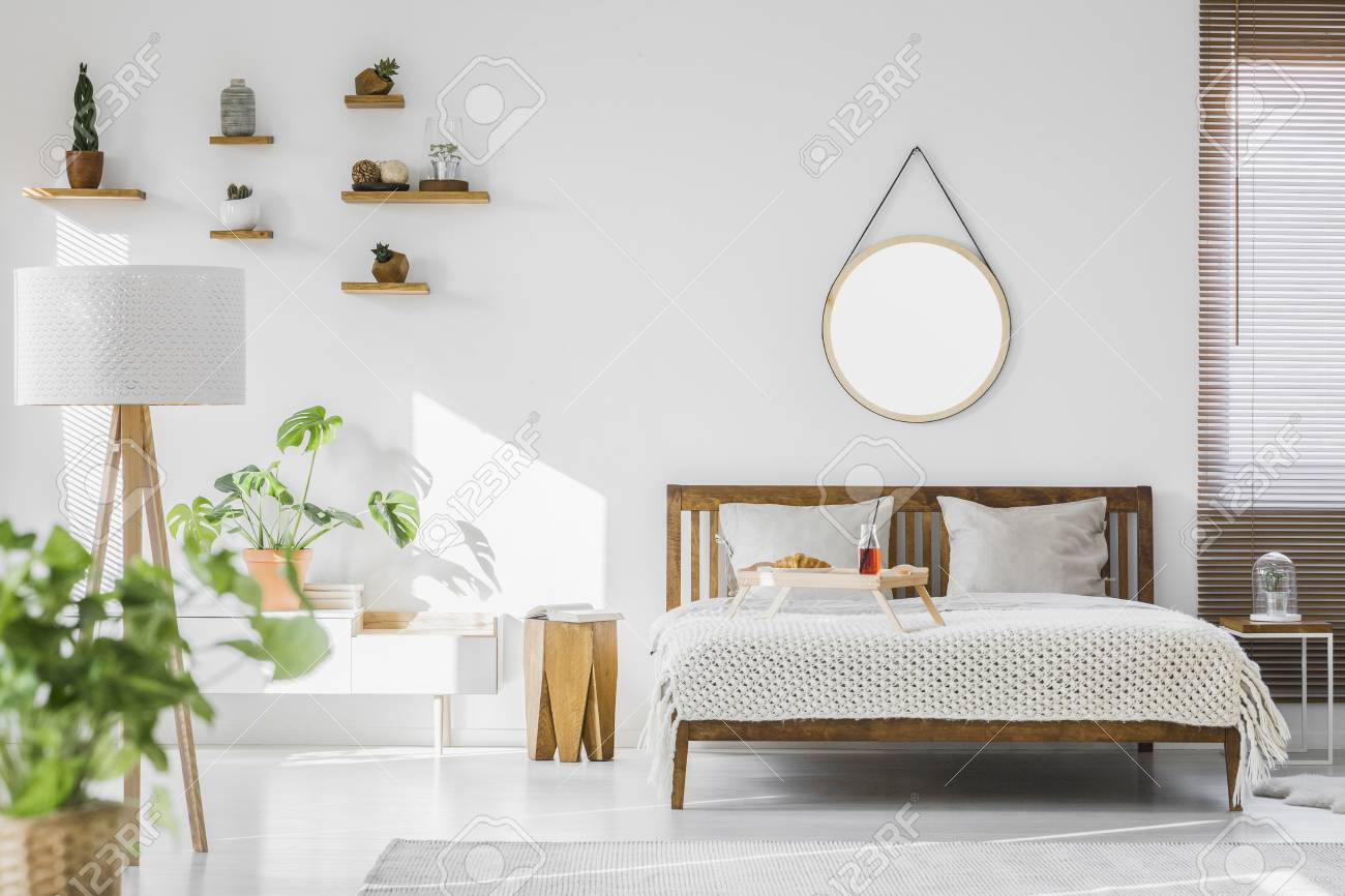 A White Sunlit Hotel Bedroom Interior With Monstera Deliciosa Stock Photo Picture And Royalty Free Image Image 104117350