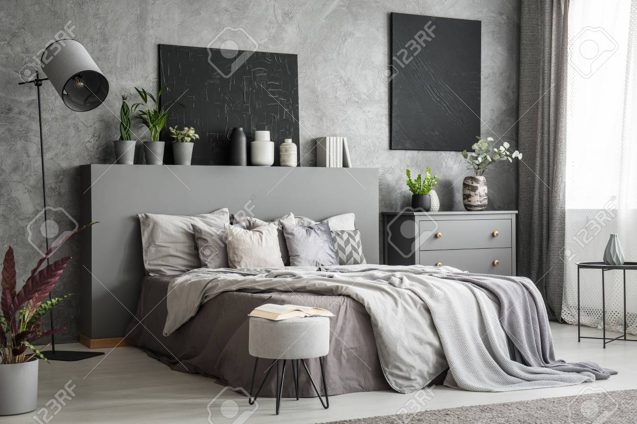 Stylish Bedroom Interior In Grey With A Big Bed With Bedsheets
