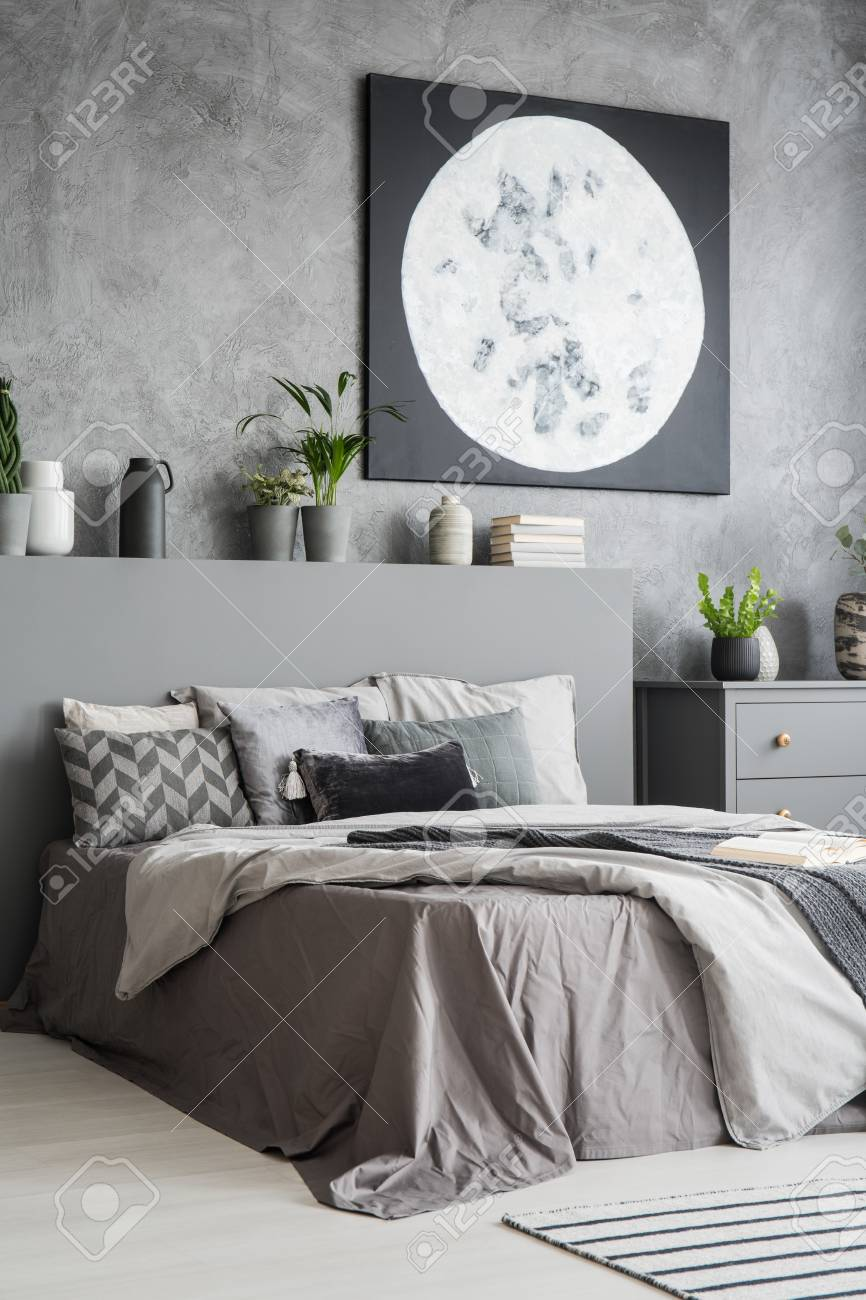 Vertical view of a modern bedroom interior in grey color with..