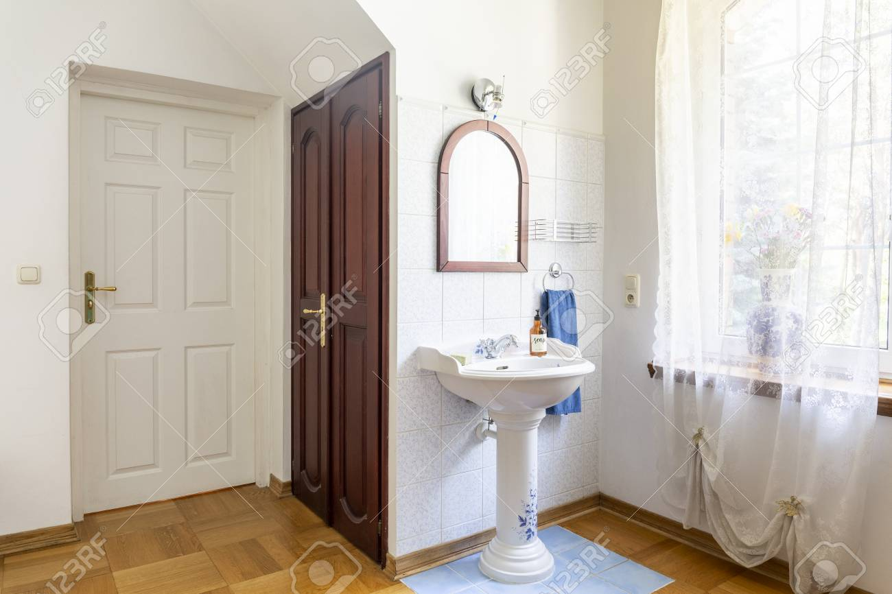 Real Photo Of A Classic Bedroom Interior With Doors Wash Basin