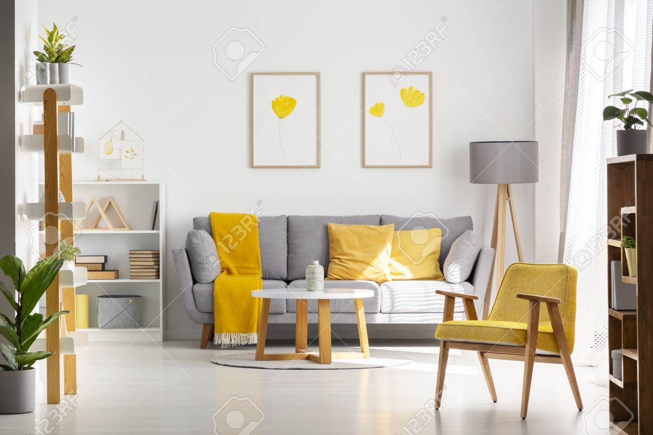 Yellow Wooden Armchair In Bright Living Room Interior With Posters