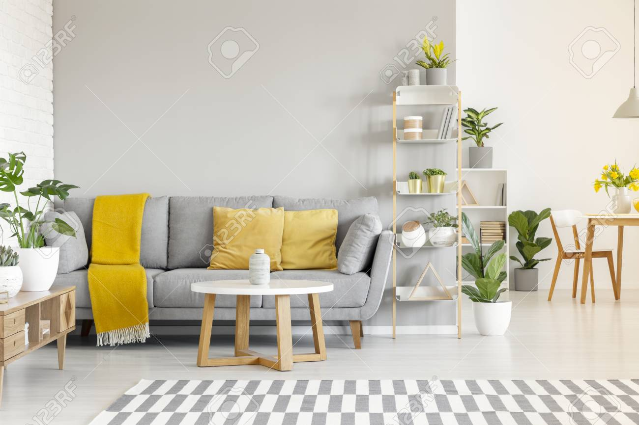 Yellow Pillows And Blanket On Grey Sofa In Modern Living Room.. Stock Photo, Picture And Royalty Free Image. Image 106022321.