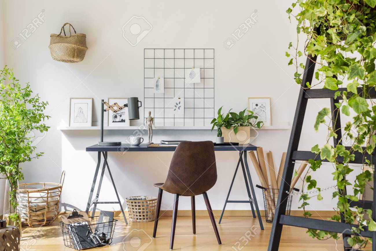 Brown Chair At Desk In White Boho Home Office Interior With Plants