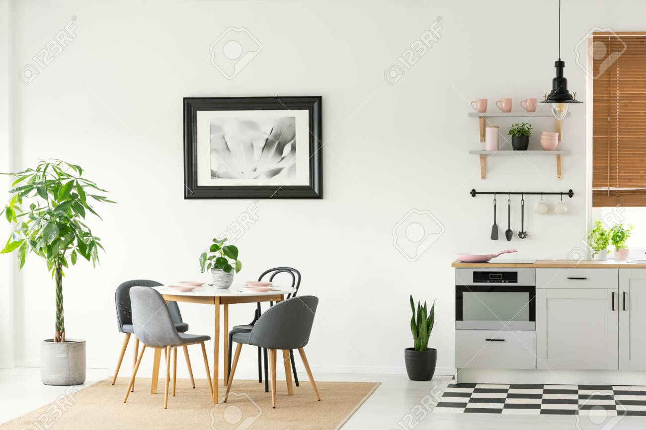 Framed Photo On A White Wall In An Open Space Dining Room And Stock Photo Picture And Royalty Free Image Image 106142404