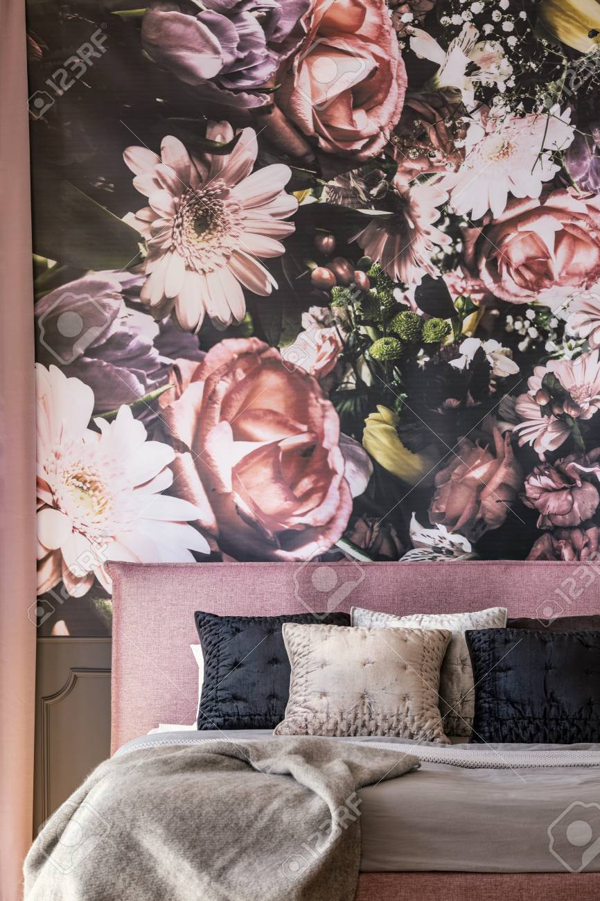 Pink And Black Pillows On Bed Against Flowers Wallpaper In Overwhelming