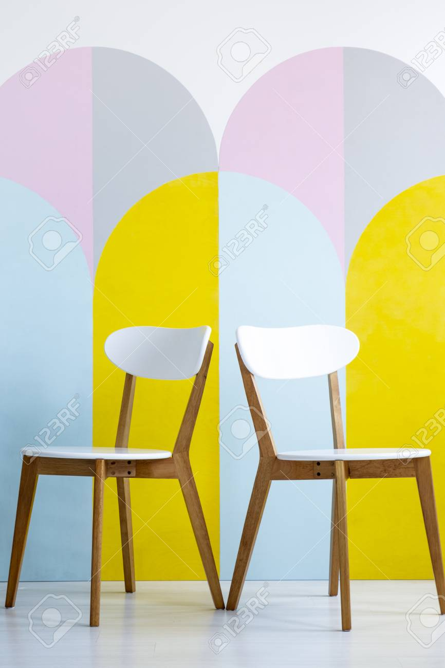 Super Two Chairs Set On A Patterned Wall With Yellow Accents In Bright Machost Co Dining Chair Design Ideas Machostcouk