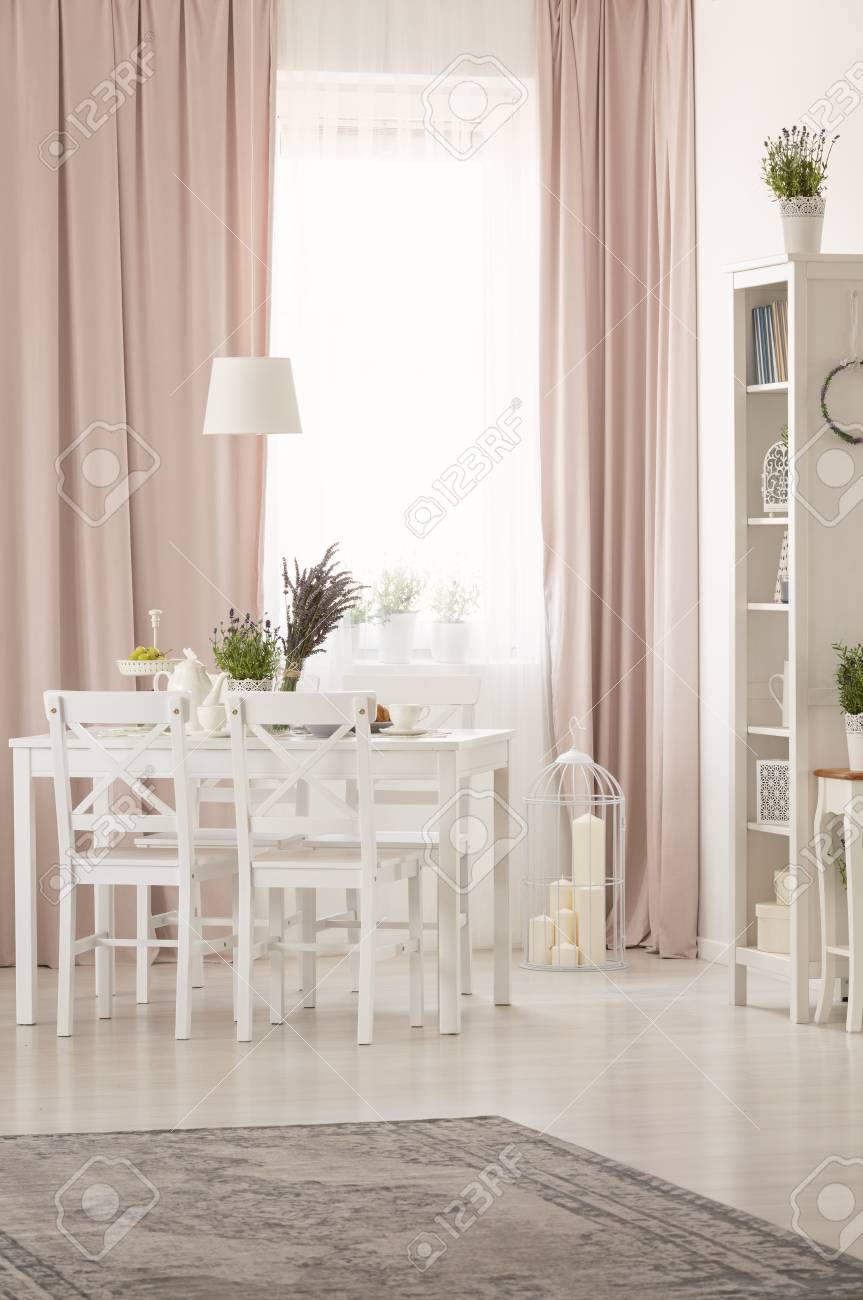 Picture of: White Chairs At Table With Plants In Pastel Pink Dining Room Stock Photo Picture And Royalty Free Image Image 107026682