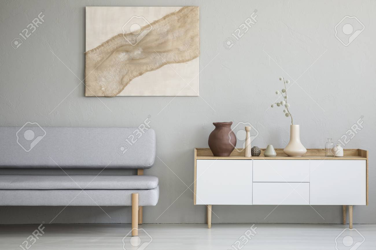 Real Photo Of A Simple Living Room Interior With A Natural Painting
