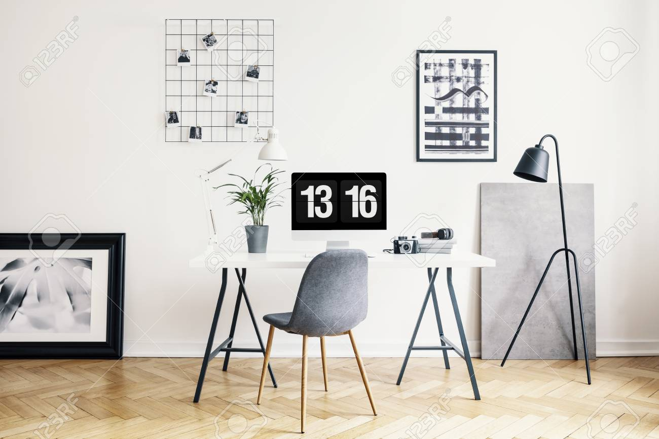 pretty nice c3bdf 35896 Lamp next to grey chair and desk with plant in white home office..
