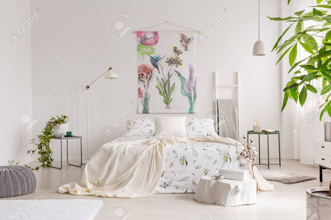 A Bright Eco Friendly Bedroom Interior With A Bed Dresses In
