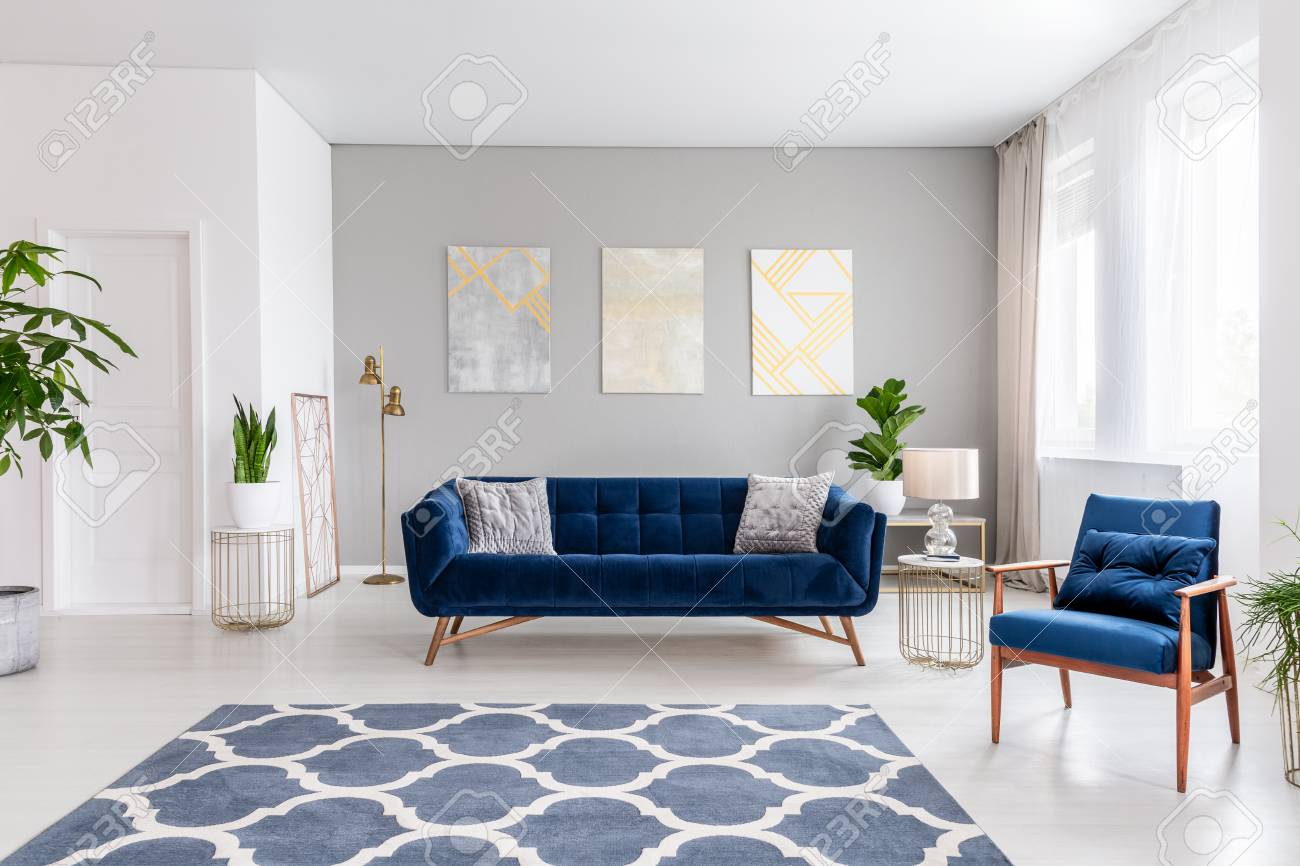 Open Space Living Room Interior With A Navy Blue Sofa And An Stock Photo Picture And Royalty Free Image Image 108021974