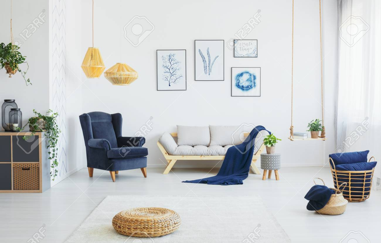Real Photo Of A Living Room Interior With Blue Accents Wicker