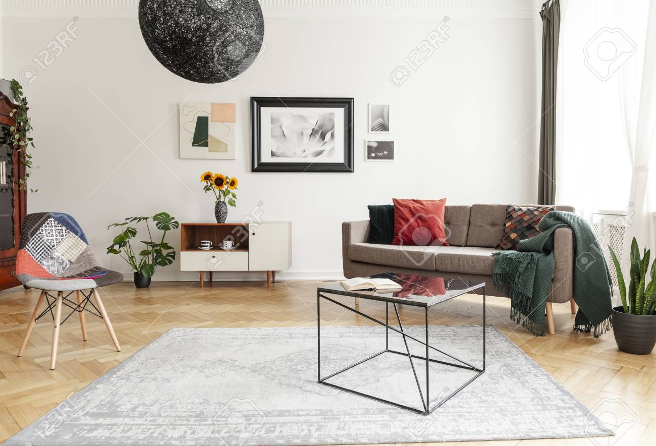 Industrial Black Coffee Table With Marble Surface And A Colorful Stock Photo Picture And Royalty Free Image Image 108186074