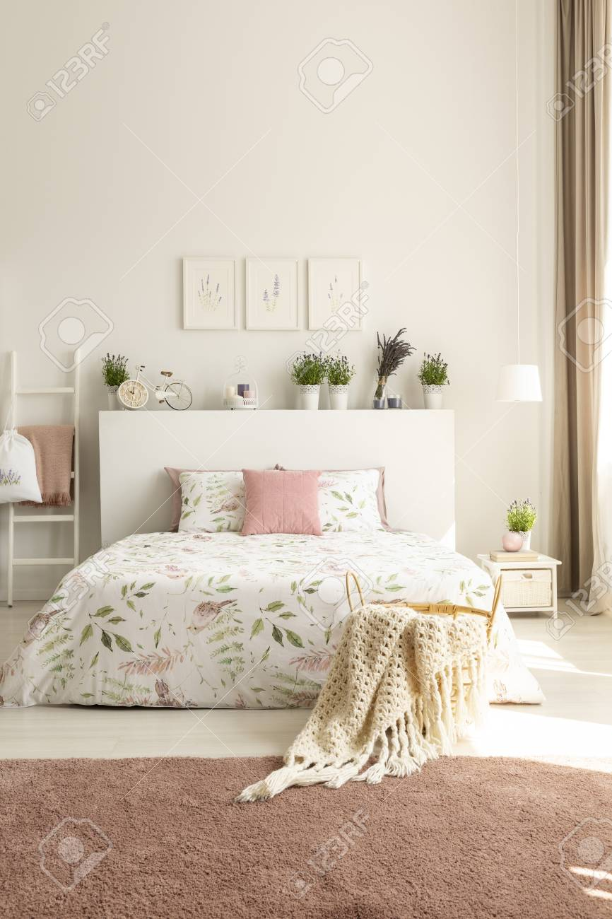 Blanket And Pillows On Bed With Plants On Headboard In Pink And Stock Photo Picture And Royalty Free Image Image 108185187