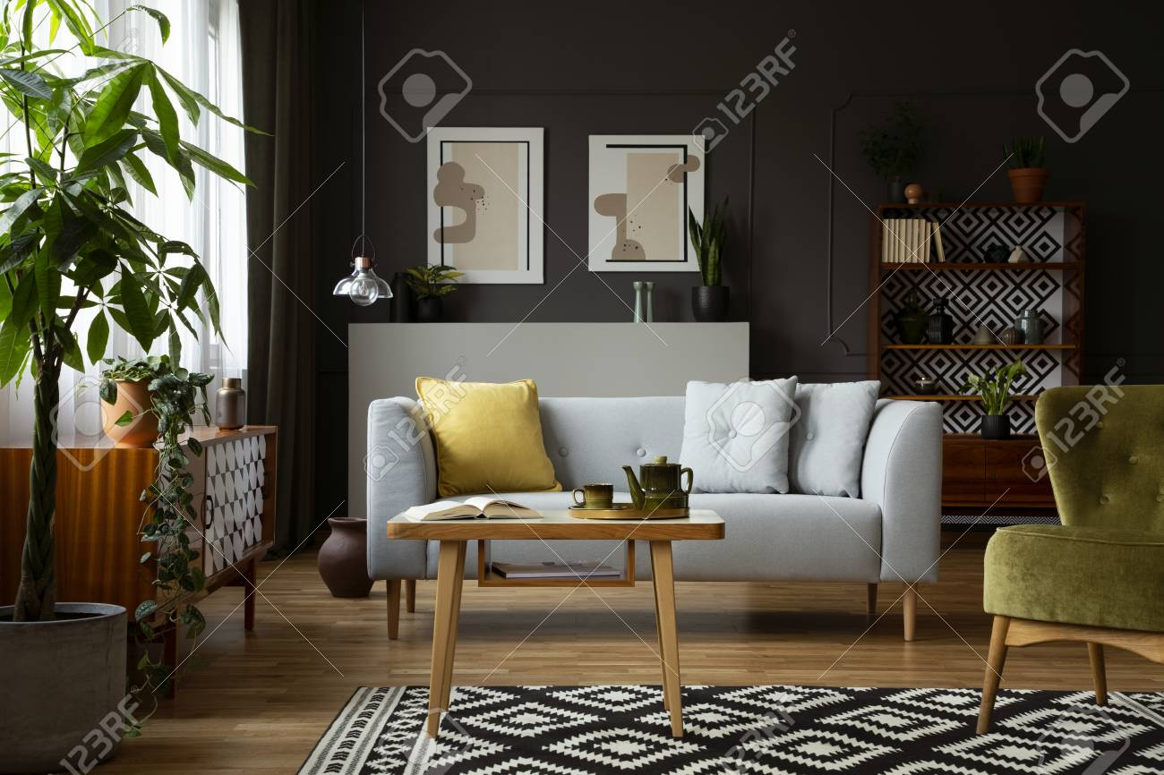 Real photo of a vintage living room interior with a coffee table,..