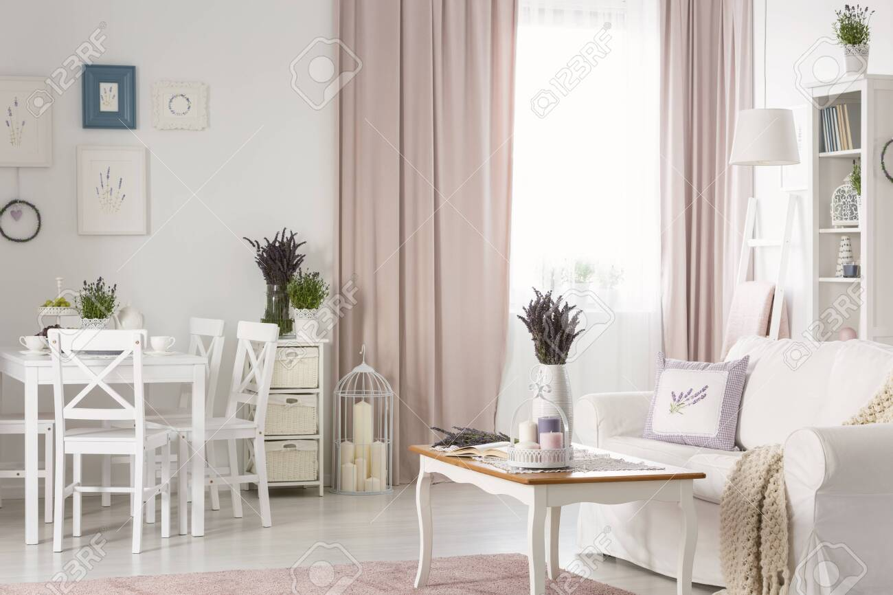 Picture of: White Chairs At Dining Table Near Posters In Flat Interior With Stock Photo Picture And Royalty Free Image Image 109284116