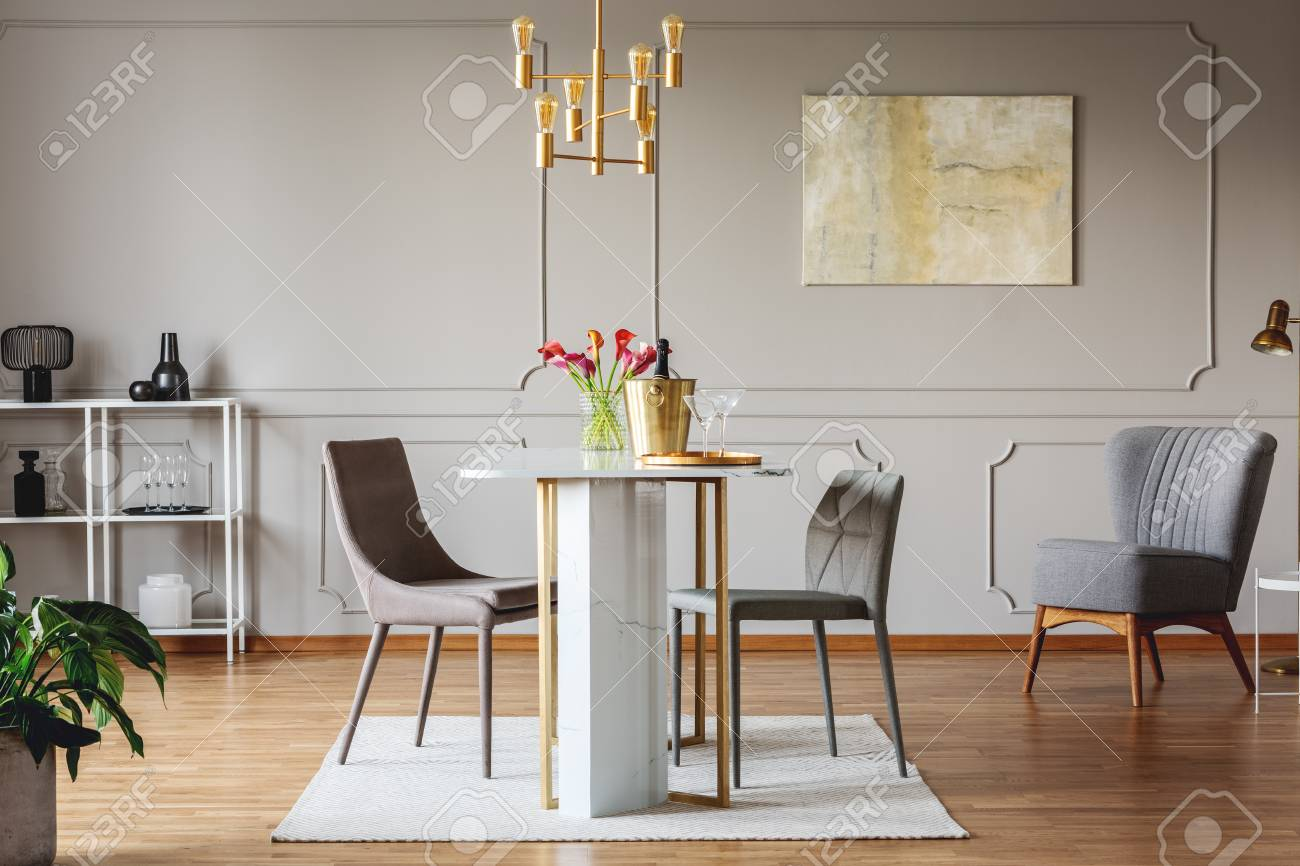 Real Photo Of An Elegant Dining Room Interior With Golden Accents Table Chairs And
