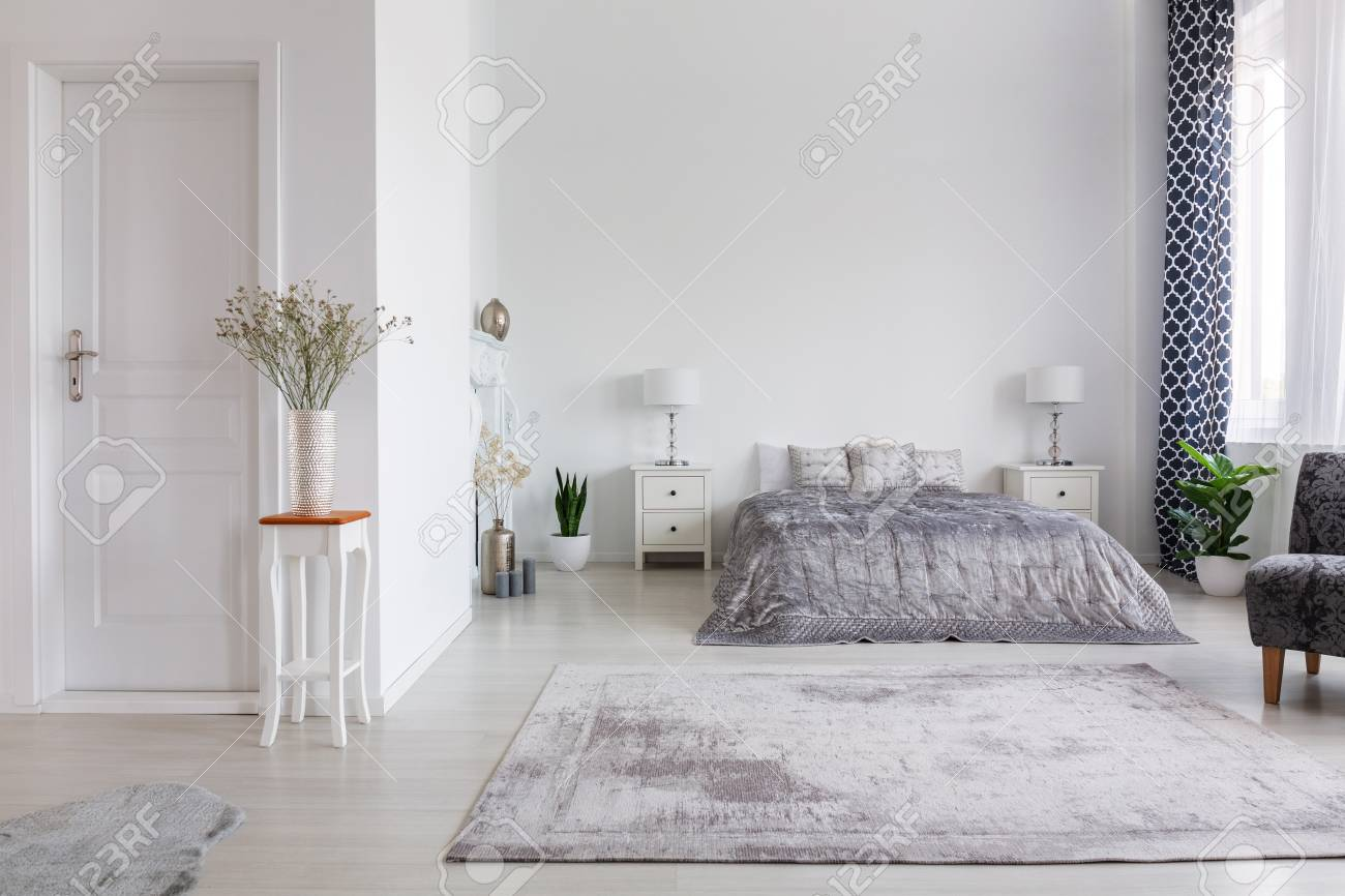 Elegant new york style bedroom with comfortable bed, real photo..