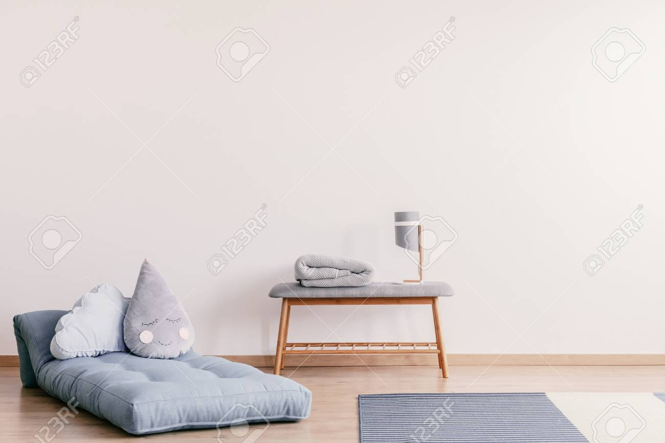 Futon With Cute Pillows On The Floor Of Stylish Baby Room Interior Stock Photo Picture And Royalty Free Image Image 110464558