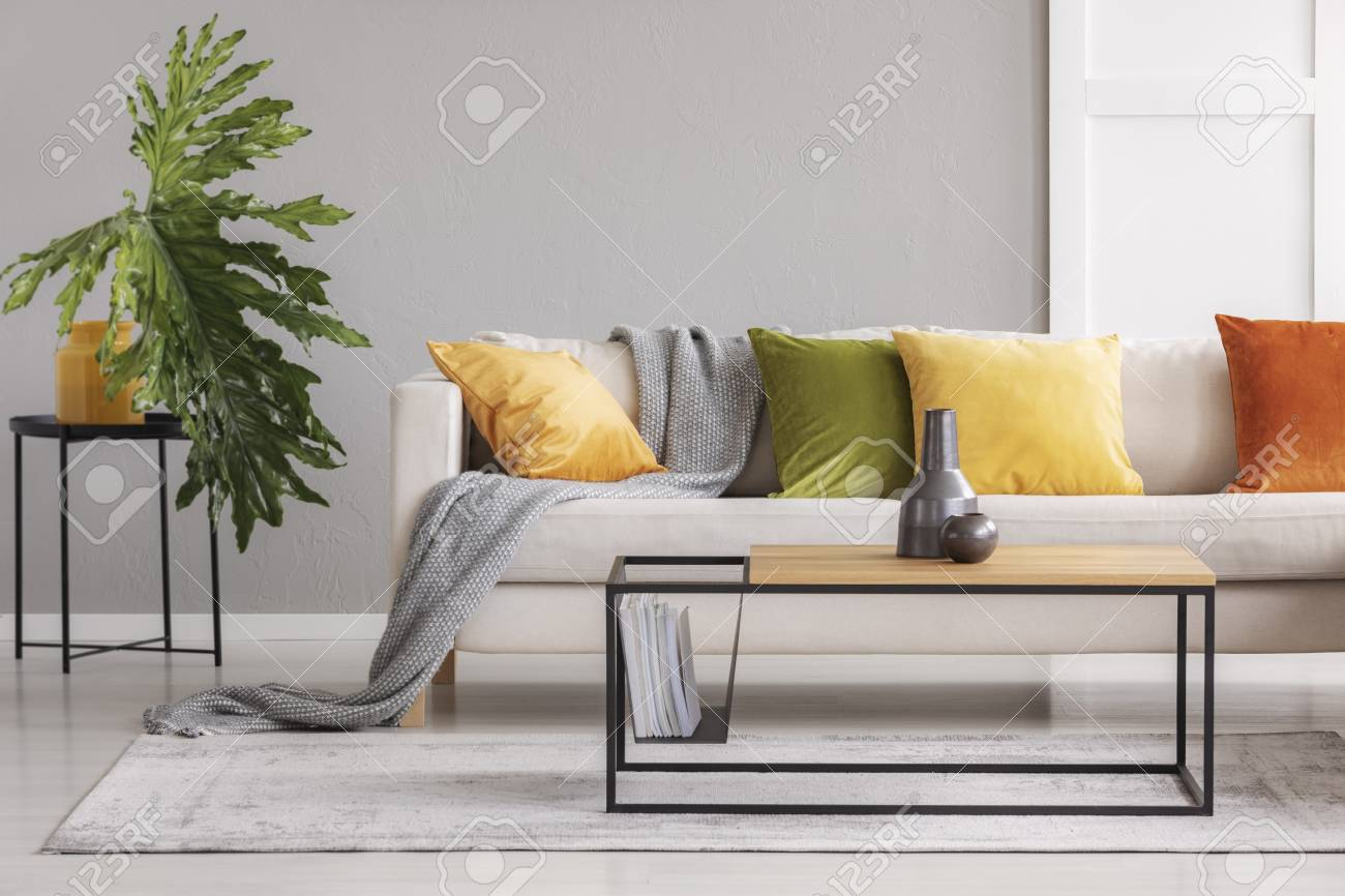 Ceramic Vases On Simple Wooden Coffee Table In Stylish Living Room With Big  Comfortable Couch With