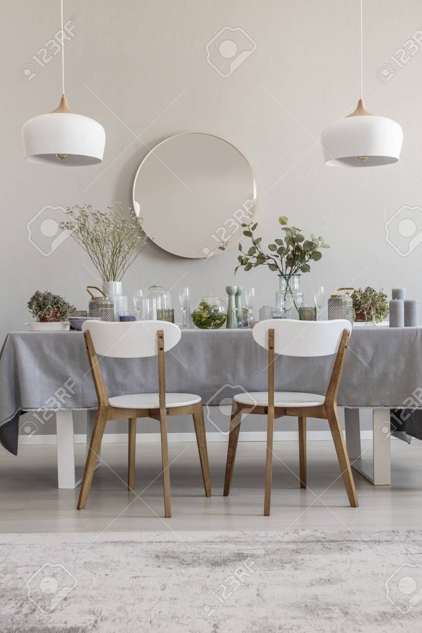 White Chairs At Table In Elegant Dining Room Interior With Round Stock Photo Picture And Royalty Free Image Image 110949038